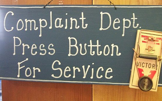 a sign for a complaints department